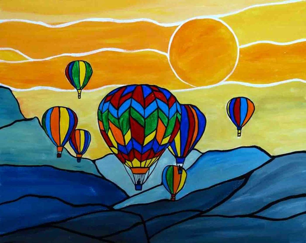 An image made up seven brightly coloured hot air balloons drifting over a range of blue mountains and rising up into a yellow and orange sky .
