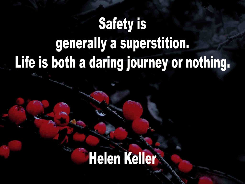 The image shows a spray of red berries on a black background on which a quotation by Hellen Keller is written.