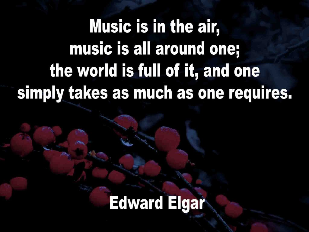 The image shows a spray of red berries on a black background on which a quotation by Edward Elgar is written. It speaks of music being all around one and one takes as much as one needs.