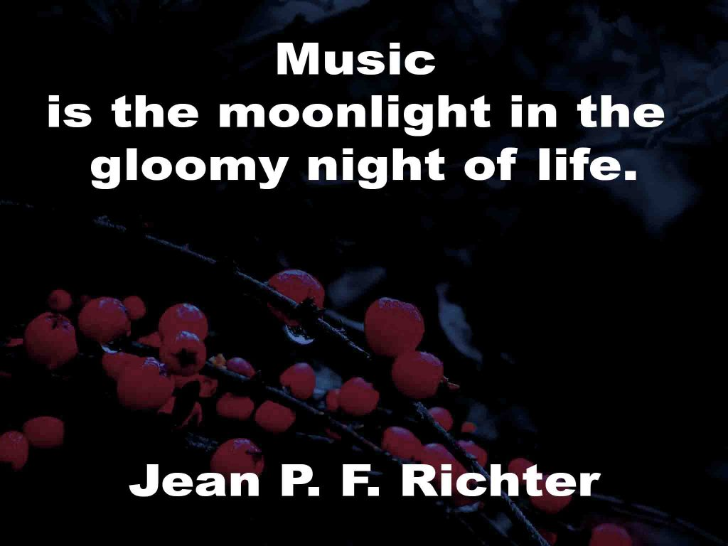 The image shows a spray of red berries on a black background on which a music quotation by Jean P. F. Richter is written. It speaks of music being the moonlight in the gloom of night.