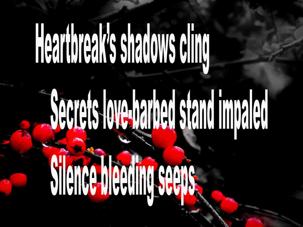 The image shows a spray of red berries on a black background on which a haiku titled Heartbreak's Shadows Cling is written. The poem speaks of heartbreak, love's barbed secrets being impaled and how silence bleeding seeps.