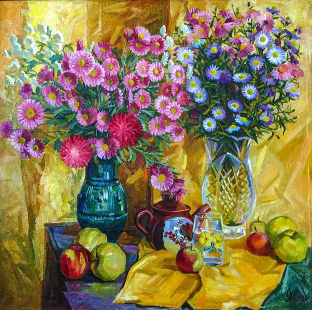 The image depicts a still life painting titled Autumn flowers by the artist Nikolai Yaravoy. Two vases, one cut glass and the other of blue ceramics holding varied coloured daises on a blue clothed table. In the foreground ther are red and green apples, a brown teapot with a floral motif, besides which stands a glass of water on a gold coloured cloth.
