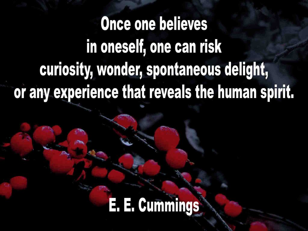 The image shows a spray of red berries on a black background on which a quotation by E. E. Cummings is written. It speaks of once one believes in oneself, one can risk curiosity, wonder, spontaneous delight, or any experiences that reveal the human spirit.
