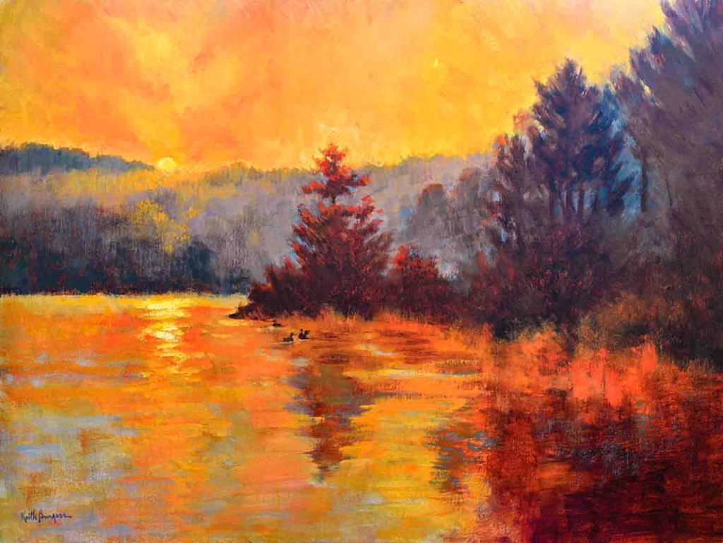 The image depicts a painting titled Golden Sunrise by the artist Keith Burgess. The work is a vibrant landscape painting depicting sunrise  over the hills with the orange golden glow reflected in a lake surrounded with purple hued pine trees..