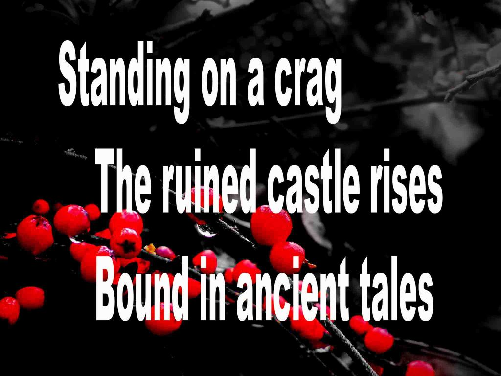 The image shows a spray of red berries on a black background on which is written a senryū poem titled Standing on a Crag by the poet Goff James. The poem speaks of a ruined castle standing on a crag and being bound in ancient tales.